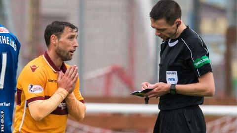 Motherwell striker Scott McDonald pleads his case to referee Kevin Clancy
