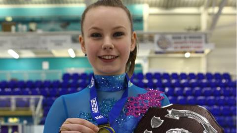 Christie Anne Shannon holds the trophy for winning the Basic Novice A British Figure Skating title