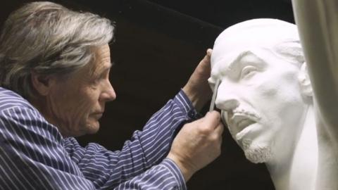 Sculptor Peter Linde works on the Zlatan statue