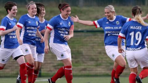 Linfield won 4-1 to secure back-to-back titles for the Belfast club. Alison Smyth celebrates with team-mates after making it 2-0 against Newry