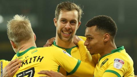 Steven Whittaker (centre) celebrates scoring for Norwich