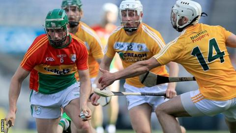 Carlow's David English drives forward in Saturday's decider against the Saffrons
