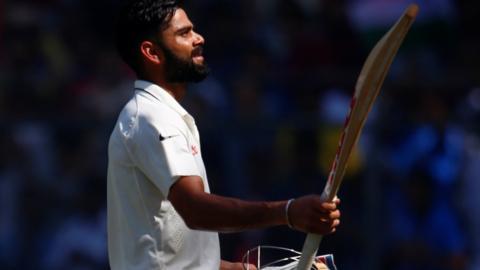 Virat Kohli acknowledges the crowd
