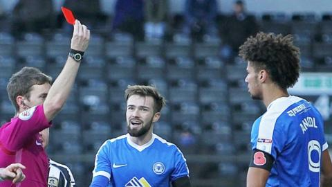 Lee Angol sees red for Peterborough