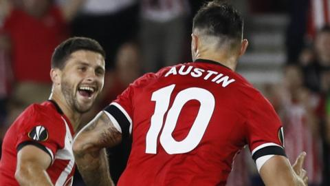 Southampton's Shane Long (left) celebrates with Charlie Austin as Southampton take the lead against Sparta Prague