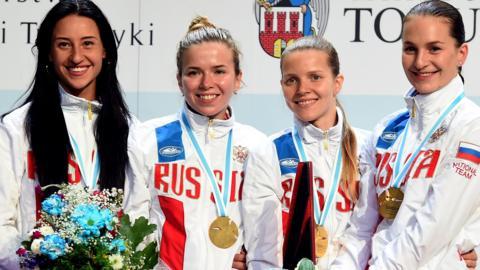 Ekaterina Dyachenko, Yana Egorian, Yuliya Gavrilova and Sofya Velikaya of Russia celebrate during the ceremony of women's sabre team at the European Fencing Championships in Poland, June 2016