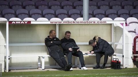 The Edinburgh coaching team provide their line-up to the match secretary