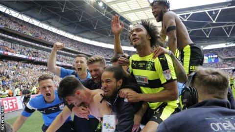 Huddersfield Town celebrate after winning promotion to the Premier League