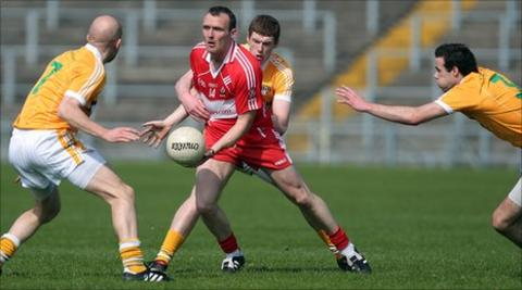 Derry forward Paddy Bradley is surrounded at Casement Park