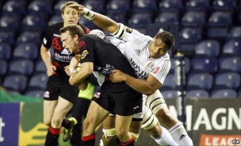 Mike Blair retains possession for Edinburgh against Aironi