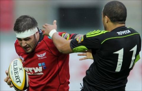 Scarlets back-row Josh Turnbull is tackled by Munster try-scorer Simon Zebo