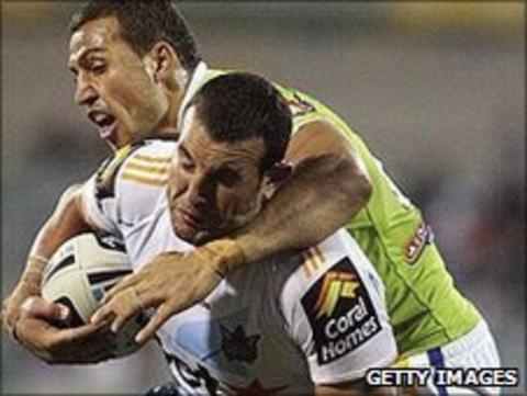 Anthony Laffranchi is tackled while playing for Gold Coast Titans