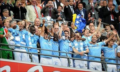 Manchester City celebrate winning the FA Cup