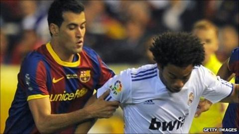 Barcelona's Sergio Busquets and Real Madrid's Marcelo during the Spanish Cup final