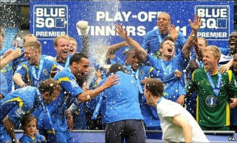 AFC Wimbledon celebrate sealing their place in the Football League