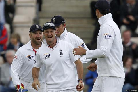 England captain Andrew Strauss is congratulated by his team-mates