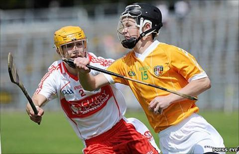 Michael Warnock of Derry in action against Antrim's Daniel McKernan