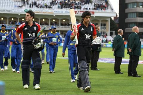 Craig Kieswetter and Alastair Cook walk off at Trent Bridge after winning the game for England