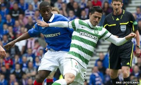 Rangers midfielder Maurice Edu and Celtic midfielder Beram Kayal