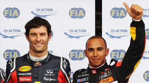 Mark Webber and Lewis Hamilton celebrate after qualifying first and second at the German Grand Prix