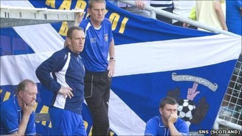 Manager Kenny Shiels surveys the action at Tannadice with his backroom team