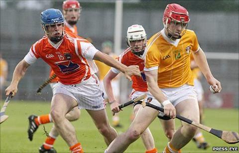 Armagh's Dean Nugent in action against Antrim captain Conor McCann