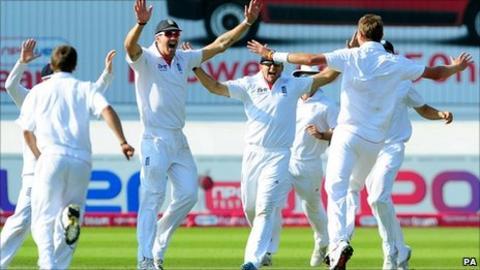 England celebrate Stuart Broad's hat-trick (Broad far right)