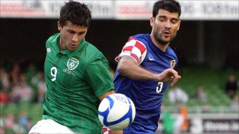 Shane Long and Vedran Corluka battle for possession in the friendly