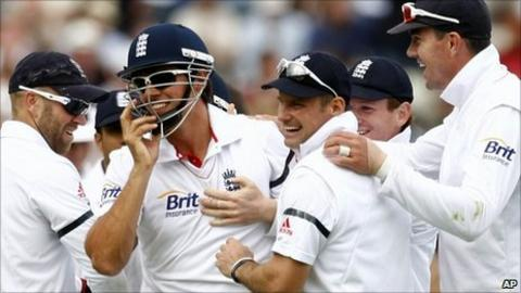 England celebrate after Alastair Cook takes a superb catch to end India's innings