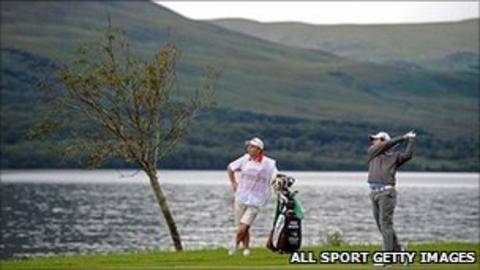 Rory McIlroy and caddy