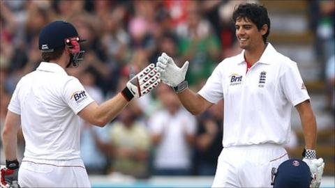 Alastair Cook (right) celebrates his double century with Eoin Morgan