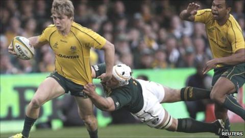 Australia wing James O'Connor tries to evade the tackle of South Africa's Heinrich Brussow