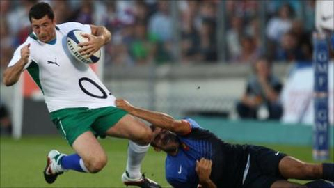 Irish full-back Rob Kearney is tackled by David Marty in Bordeaux
