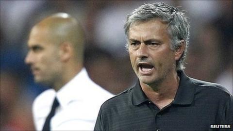 Jose Mourinho (right) with Barca boss Pep Guardiola (background, left)