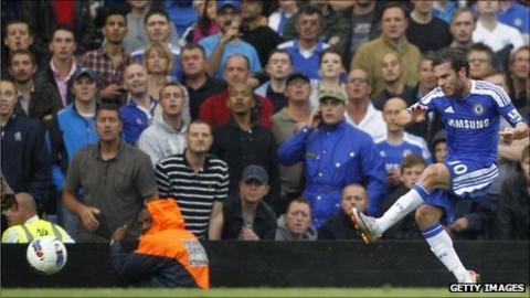 Juan Mata curls home Chelsea's third