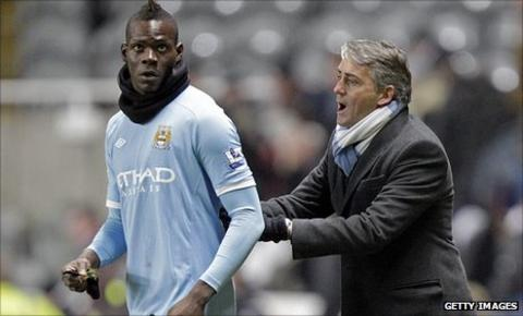 Mario Balotelli, left, and Roberto Mancini
