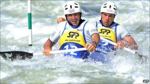 David Florence (L) and Richard Hounslow of Britain compete in the C2 men's final race