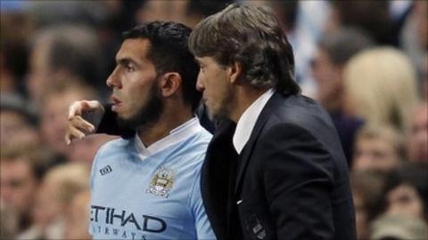Carlos Tevez and Roberto Mancini