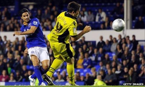 Mikel Arteta (left) scores against Sheffield United
