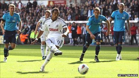 Winger Scott Sinclair fires home from the penalty spot for Swansea's first Premier League goal