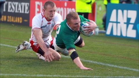 Keith Earls goes over for his first try against Russia