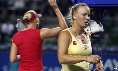 Caroline Wozniacki heads back to her chair after being beaten by Kaia Kanepi