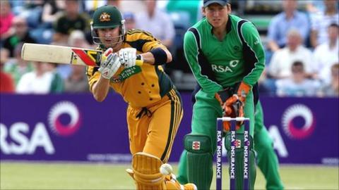 Australia captain Michael Clarke clips the ball away in last year's game at Clontarf