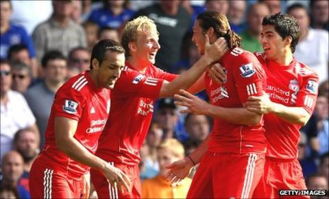 Jubilant Liverpool players congratulate Andy Carroll after the opening goal