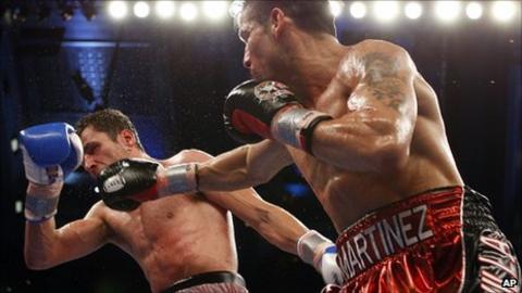 Darren Barker (left) is hit by Sergio Martinez