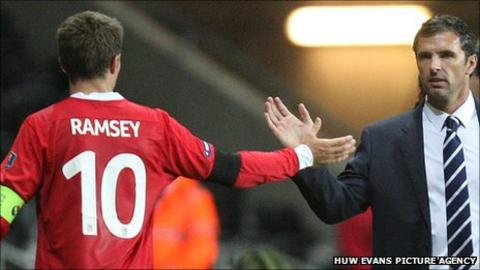 Wales manager Gary Speed congratulates captain Aaron Ramsey