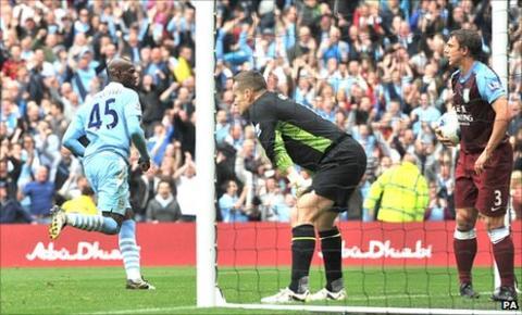 Mario Balotelli puts Manchester City ahead against Aston villa