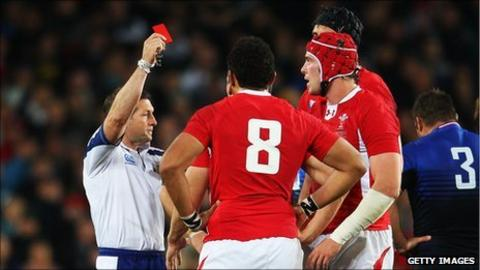 Referee Alain Rolland dismisses Wales captiain Sam Warburton