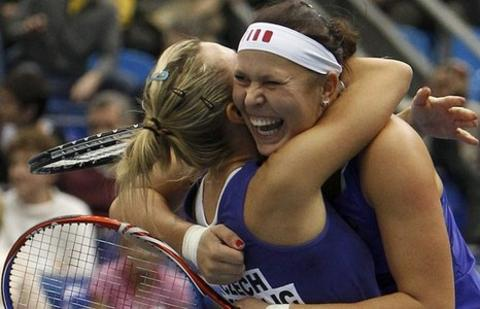 The Czech Republic's Lucie Hradecka (right) and Kveta Peschke react after defeating Russia's Elena Vesnina and Maria Kirilenko in the Fed Cup final
