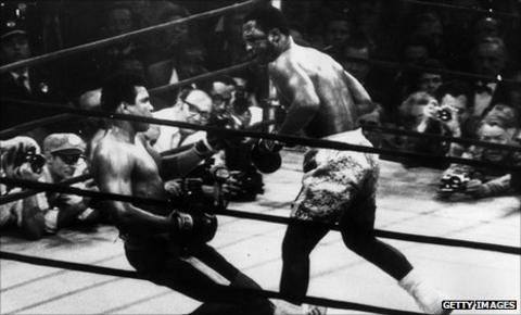 Joe Frazier floors Muhammad Ali in their first fight in New York